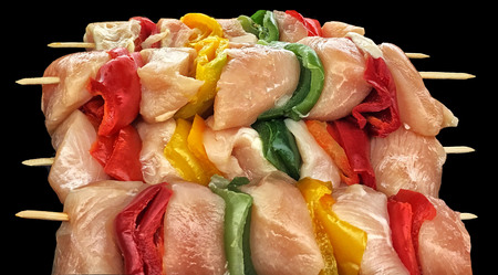Really Nice Image of fresh chicken Kabobs on Black ready to cook Stock Photo