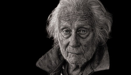 Nice Emotional Studio Portrait of a Senior Man On Black 写真素材