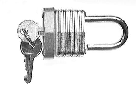 Macro closeup of Unlocked Padlock with keys  isolated Imagens