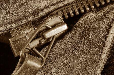 Macro of zipper on leather jacket