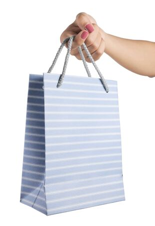 woman hand with shopping bags isolated on white background