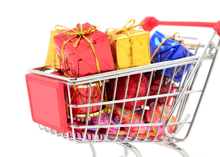Shopping cart with gifts new year and Christmas gifts photo