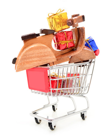 Christmas shopping cart with gifts and toys photo