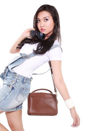 odd: beautiful girl posing odd, isolated on white background Stock Photo