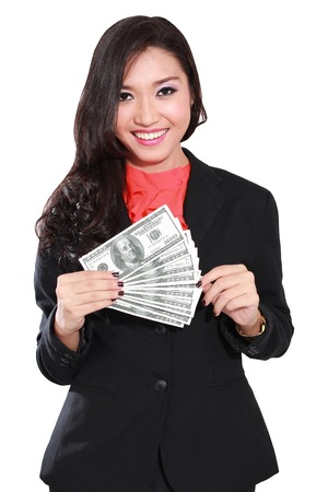 money notes: young businesswoman with dollars in her hands, isolated on white background