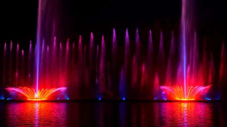 Night laser fountain show, on the Roshen embankment, the Ukrainian city of Vinnitsa.Musical fountain with laser animations.Musical fountain Roshen in Vinnitsa, Ukraine.Evening show Roshen fountain. Stock fotó