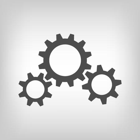 Three grey gear wheels on white background
