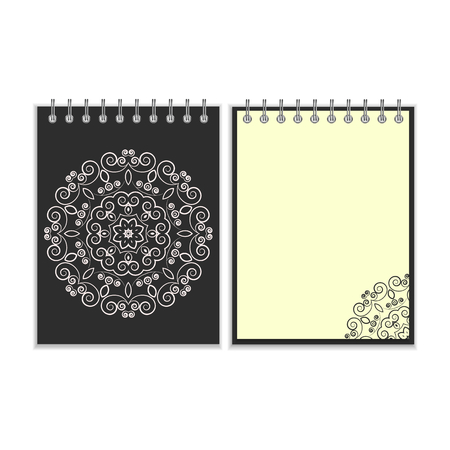 notebook cover: Black cover notebook with ornate floral white round pattern and same design element on the pages. Isolated on white background