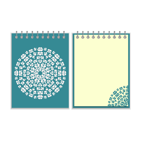 Blue cover notebook with ornate white round pattern and same design element on the pages. Isolated on white background