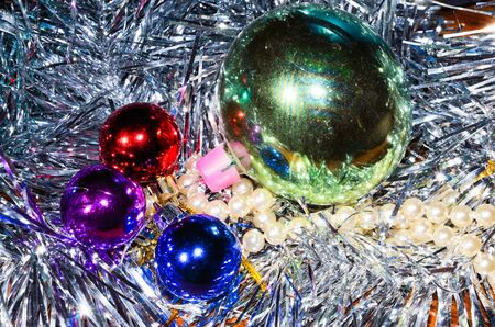 Closeup of colorful christmas balls with tinsel photo