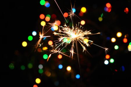 Christmas sparkler and background of colorful bokeh Stock Photo - 15736239