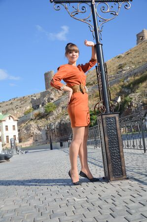 Beautiful young woman standing at the quay