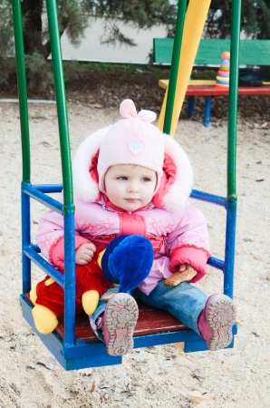 Portrait of cute baby on the swing photo