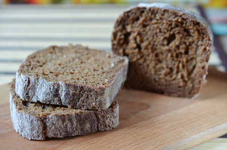 Fresh brown bread on the board Stock Photo