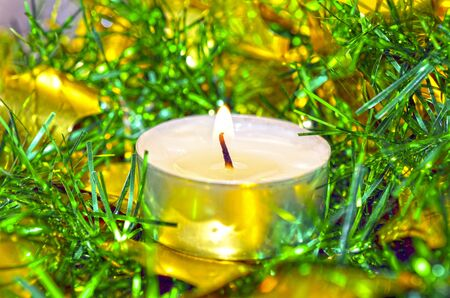 the tinsel: One white candle with christmas green tinsel