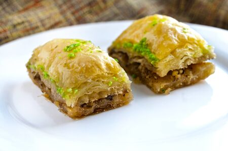 Close up of sweet baklava on white plate Stock Photo