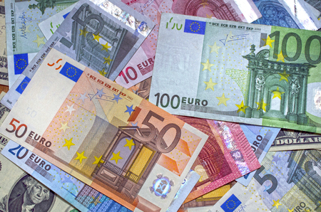 denomination: Background of Close up euro and dollars different  denomination Stock Photo