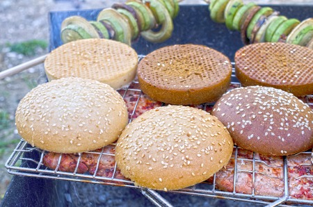 Backgrund of Tasty meat with buns on grill Stock Photo
