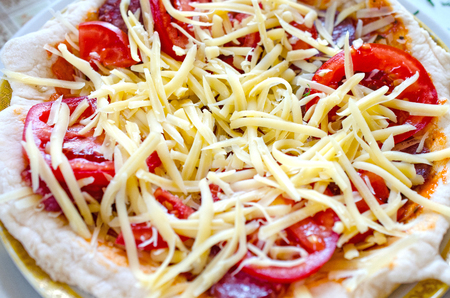 Background of Close up of tasty pizza with chicken, tomato and cheese Stock Photo
