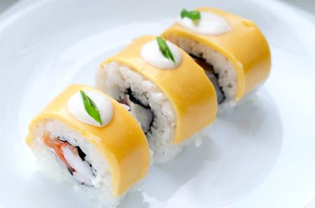 Close up of tasty fresh sushi rolls on plate Stock Photo