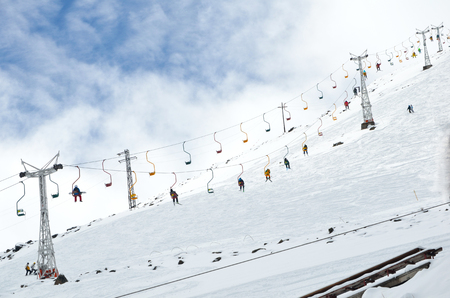 Cable car lift at beautiful slopes of the Caucasus Mountains, Elbrus Stock Photo