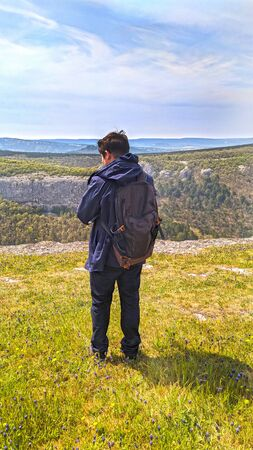 Man standing back over beautiful view of canyon