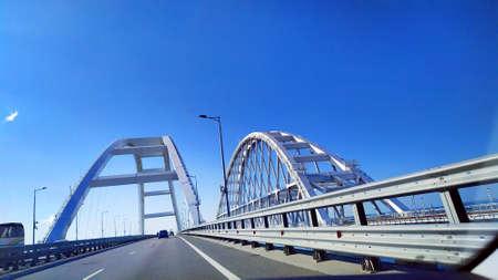 Crimean bridge, Kerch, Taman, Russia - August 3, 2020: Road at Crimean bridge. Cars driving along Crimean bridge.