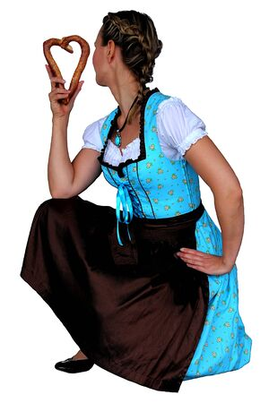 kerb: Attractive girl with pretzel in her hand in traditional Bavarian dress