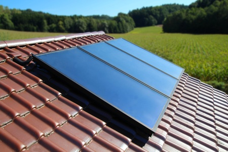 Solar collector on a cottage in the country