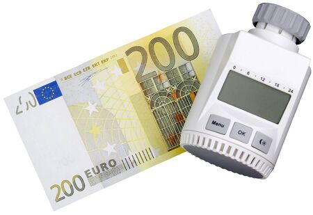 A thermostat for radiator with a 200 Euro bill Stock Photo - 10765722
