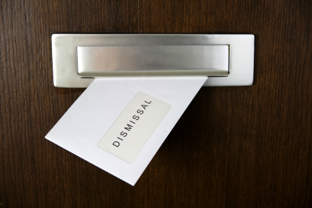 residue: A letter in a letterbox of a door, written DISMISSAL