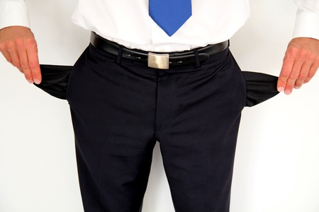 A business man with empty trouser pockets Standard-Bild