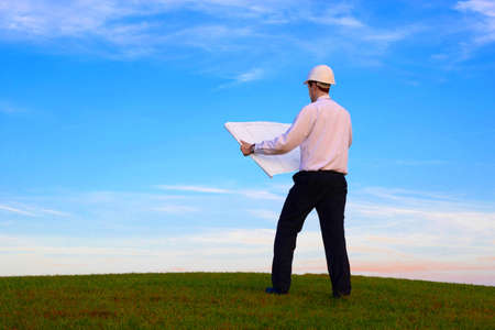 Man with a white plan standing on a green meadow Stock Photo - 11179461