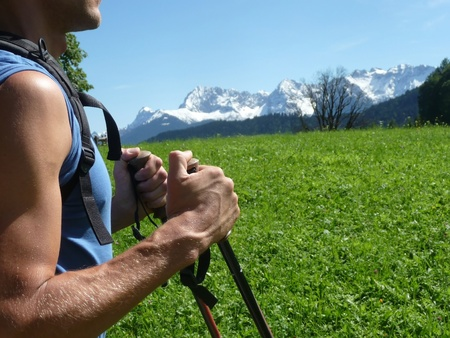trekking pole: A young muscular man hiking with poles Stock Photo