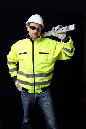 Building Worker with level black Stock Photo - 12054700