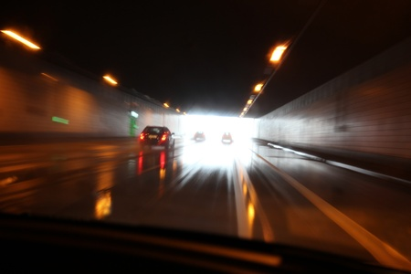 hydroplaning: Aquaplaning in a tunel with wet street Editorial