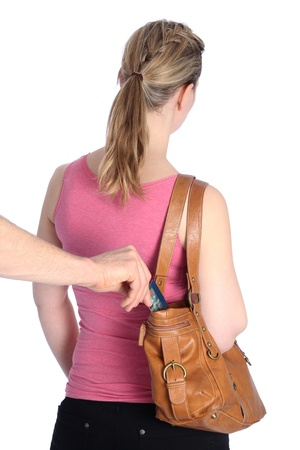 Pickpocketing a Creditcard out of a handbag of a woman Stock Photo - 12545339