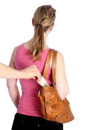 Pickpocketing out of a handbag Stock Photo - 12545347