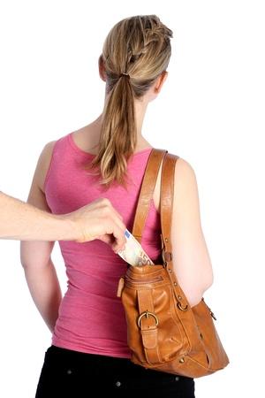 pulling money: Pickpocketing out of a handbag