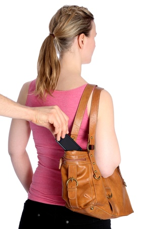 Pickpocketing out of a handbag