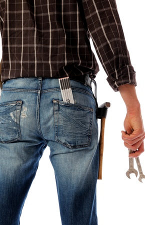 Construction worker with two wrenches and hammer Standard-Bild