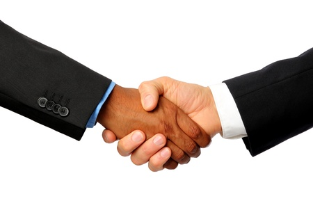 International Handshake with white and dark skined businessman Stock Photo