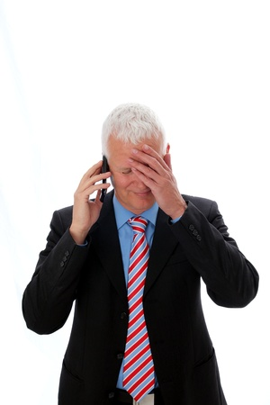 Businessman disappointed and sad calling with hand on forehead Stock Photo - 12867484