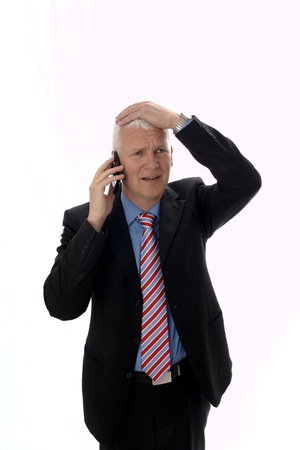 gray haired: Businessman disappointed calling and sad Hand on head