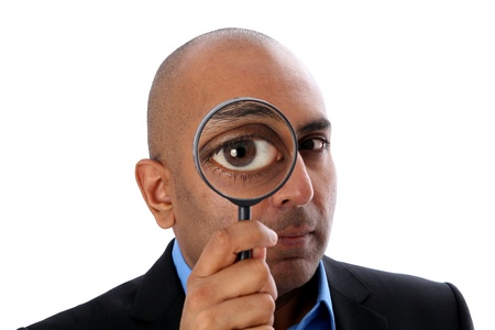 Indian o african Man with magnifying glass photo