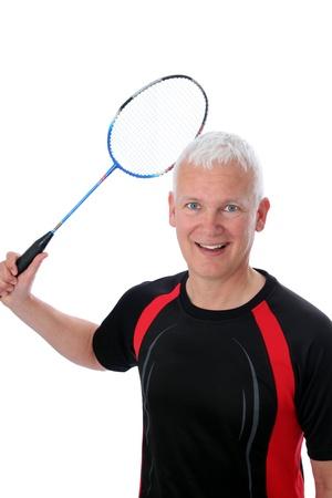 Grey active Senior with badminton racket over head