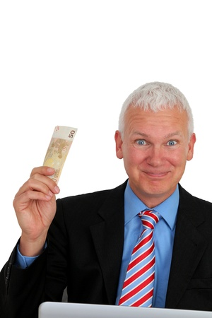 e auction: Senior Businessman with money and laptop laughing