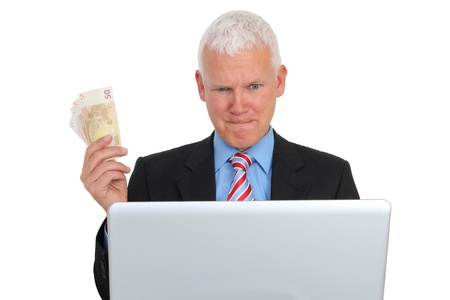 e auction: Businessman with Bills and Laptop on Sofa isolated