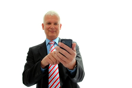gray haired: Senior Businessman with mobile phone isolated Stock Photo
