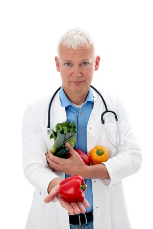 Doctor with vegetables presentating on his hand photo